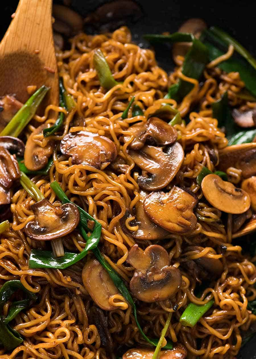 Close up of Asian Mushroom Ramen Noodles in a black skillet, fresh off the stove