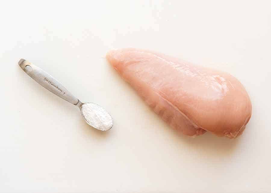 Photo of baking soda and raw chicken breast - to tenderise chicken