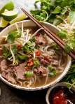 Beef Pho in a bowl, ready to be eaten