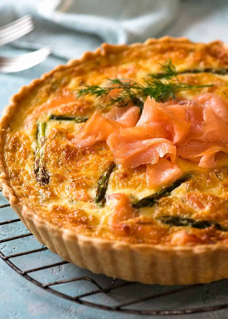 Homemade Salmon Quiche made with smoked salmon cooling on a rack, fresh out of the oven