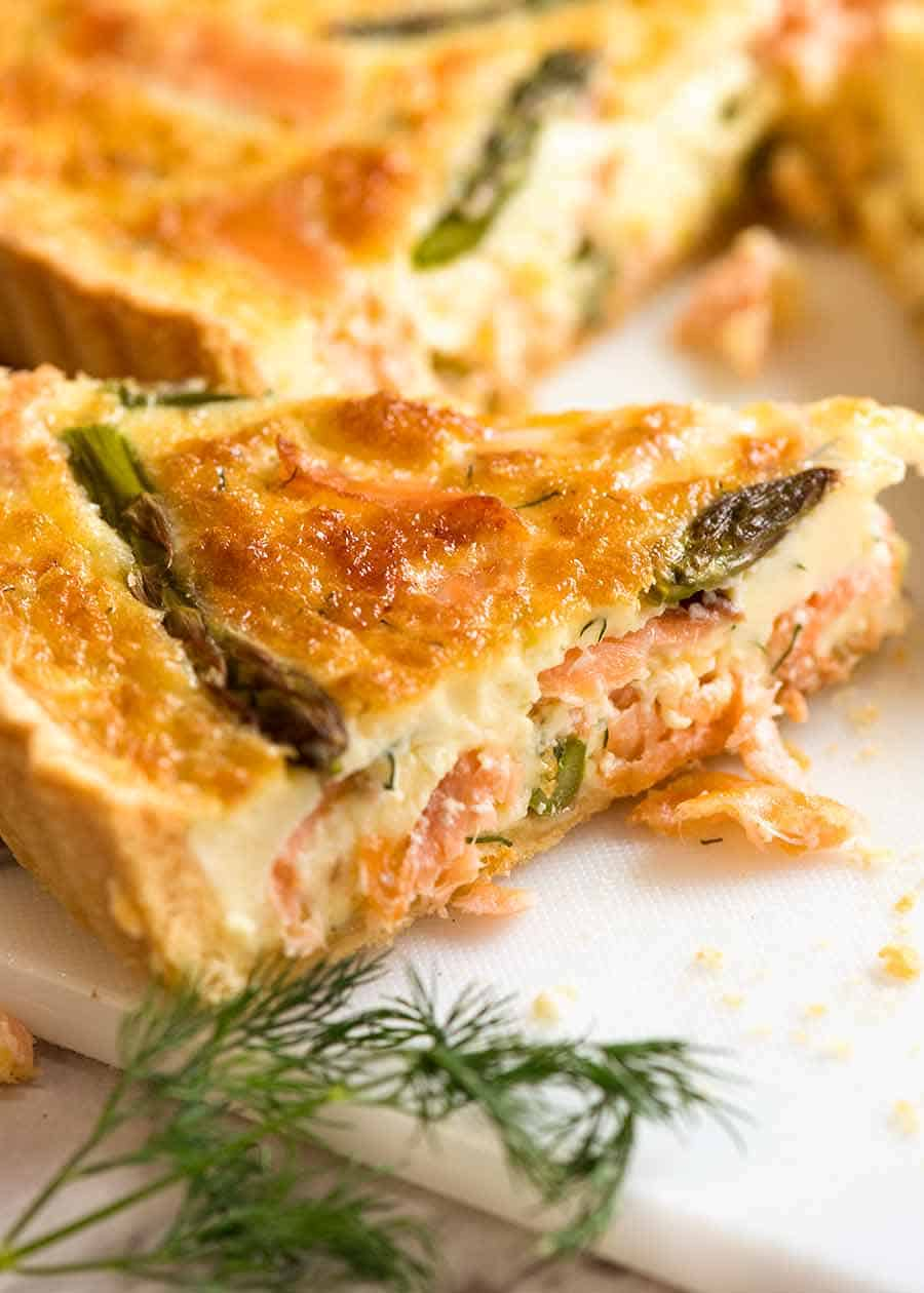 slices of salmon quiche on plate