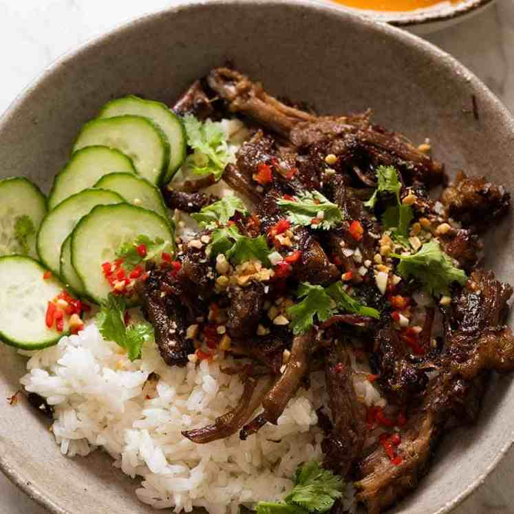 Caramelised Vietnamese Shredded Beef in a bowl with Nuoc Cham on the side