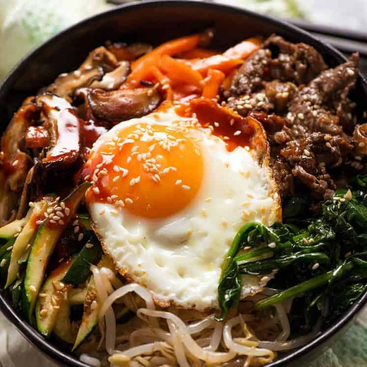 Close up of Bibimbap Korean Rice Bowl with Bibimbap Sauce, ready to be eaten
