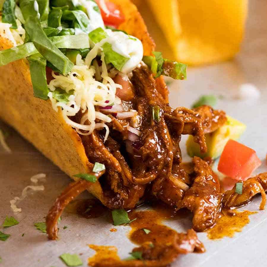 Juicy quick chicken taco filling inside crispy taco shells