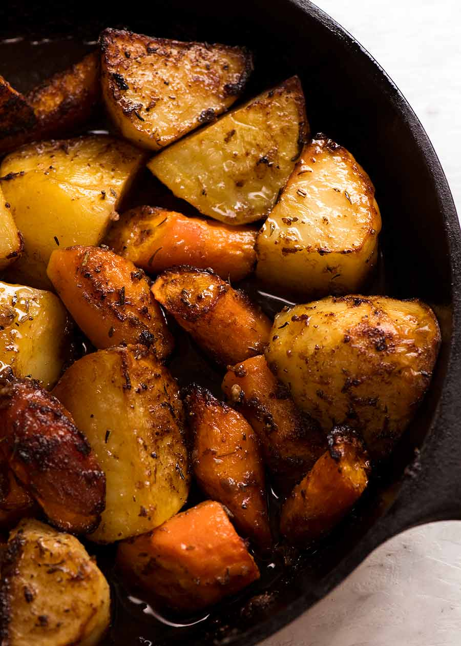 Roasted Vegetables with Marinated Roast Beef in a black skillet