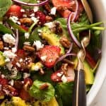 Close up of Strawberry Salad with Avocado in a white bowl, ready to be served