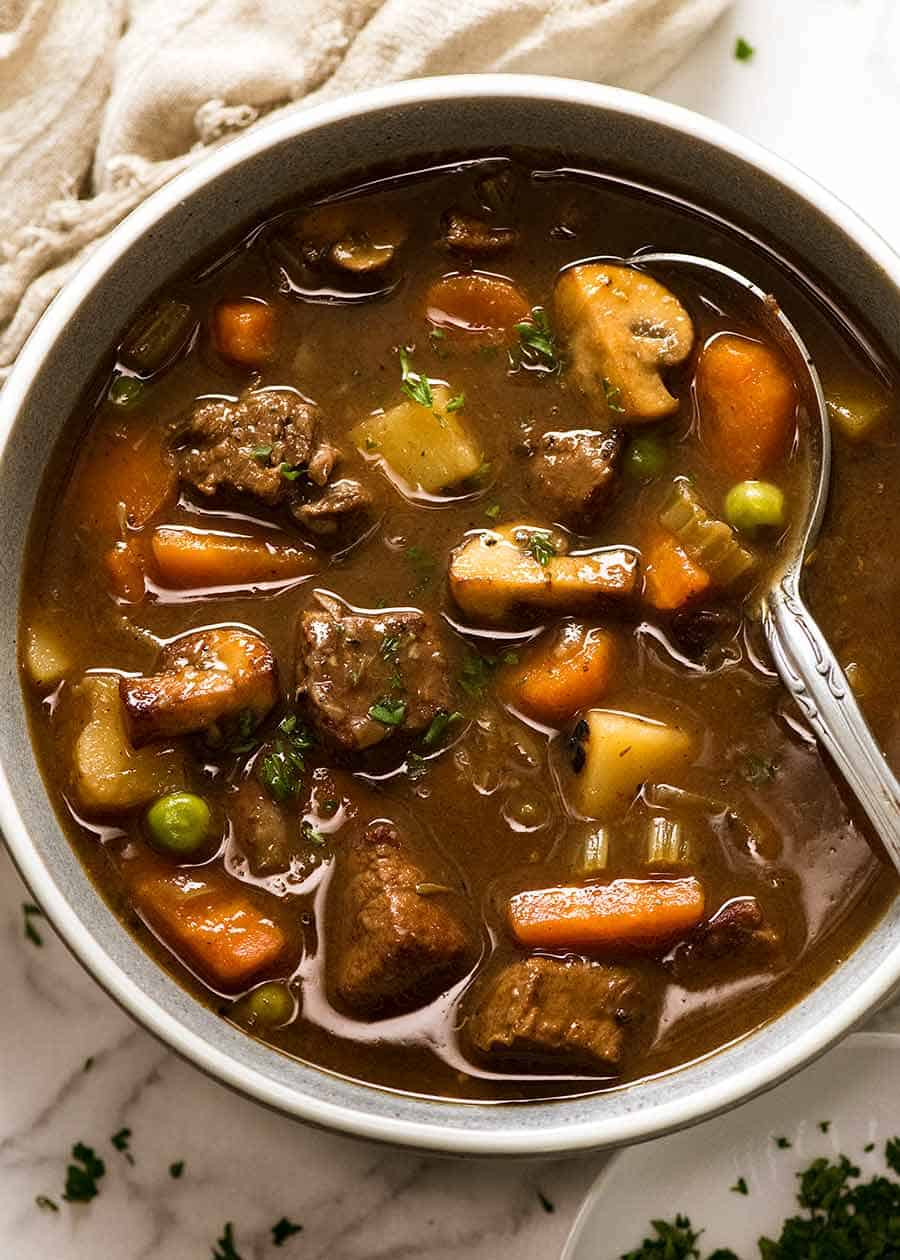 Overhead photo of Vegetable Beef Soup with tender, slow cooked beef in a bowl, ready to be eaten