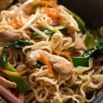 Close up of Chow Mein Ramen Noodles in a rustic black bowl, ready to be eaten