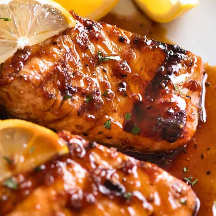 Close up of Marinated Grilled Salmon with lemon wedges