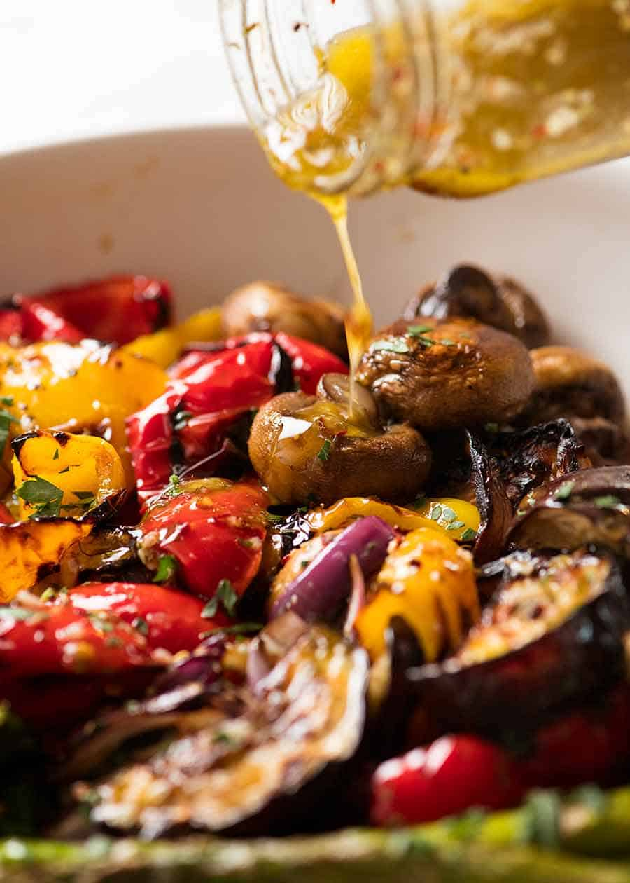 Pouring Marinade over grilled vegetables
