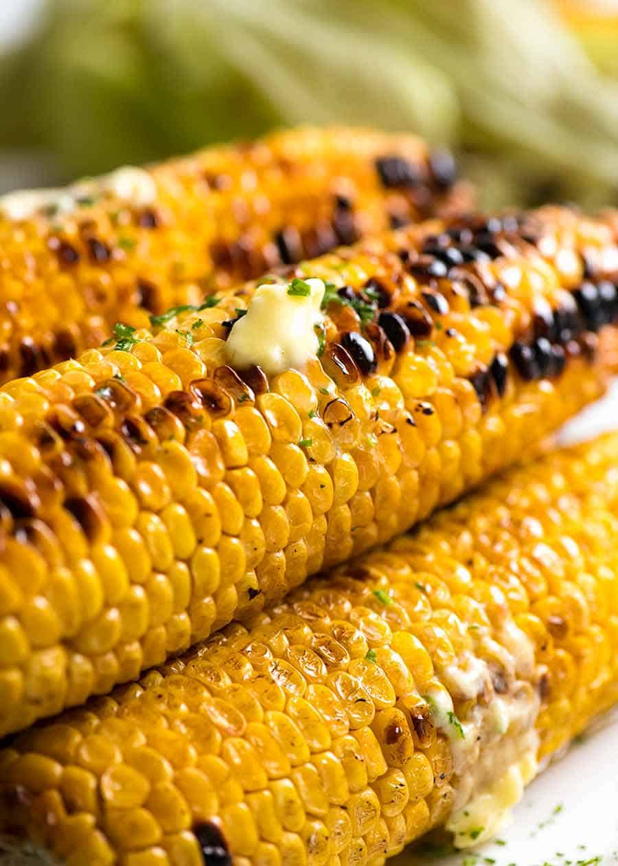 How to grill corn - Stack of Grilled Corn with melting butter