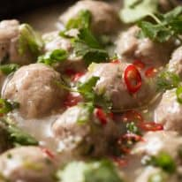 Vietnamese Pork Meatballs for Banh Mi in a black skillet, ready to be served