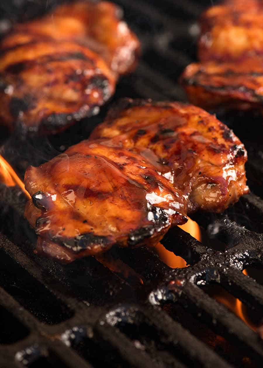 Sticky chicken being grilled on the BBQ