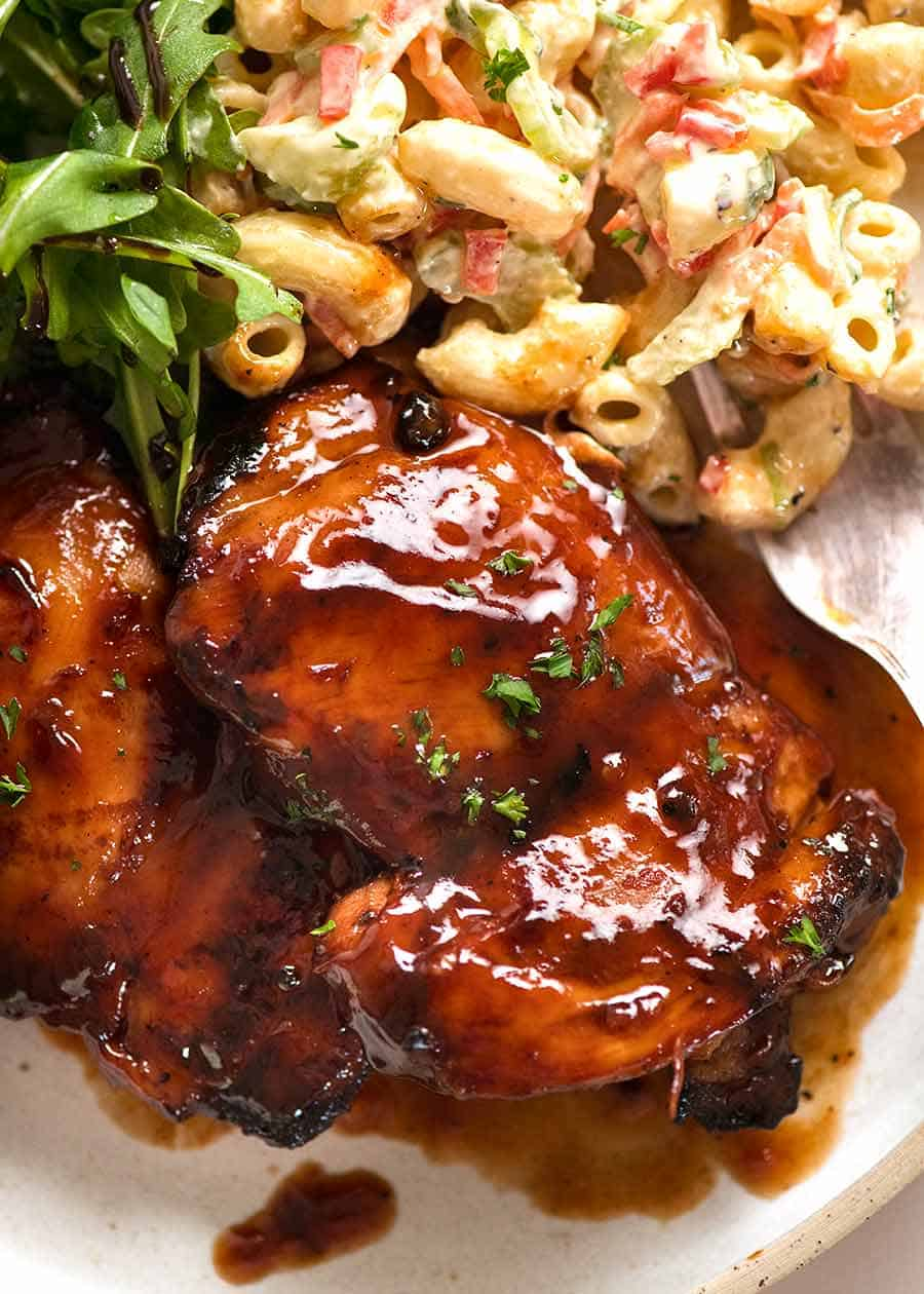 Sticky Grilled Chicken in a plate with a side of Macaroni Salad and Rocket Salad