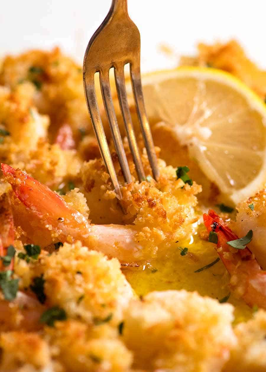 Fork picking up Baked Prawn in Lemon Garlic Butter Sauce