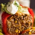 Mexican Stuffed Pepper cut open to reveal Mexican flavoured beef and rice filling