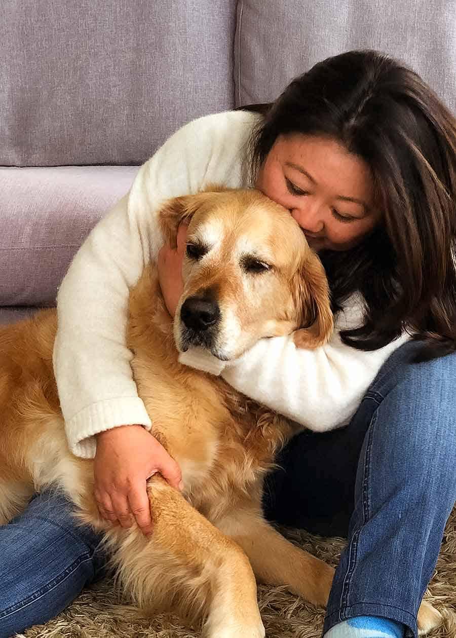 Nagi kissing Dozer the golden retriever goodbye