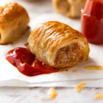 Close up of Sausage Rolls with tomato sauce
