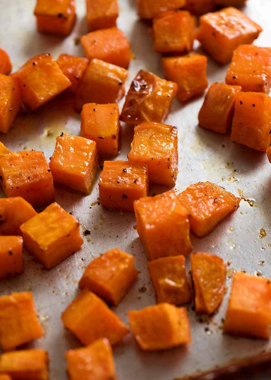 Roasted Sweet Potato Cubes on a tray, fresh out of the oven