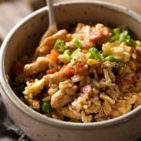 Chicken Fried Rice in a white bowl, ready to be eaten