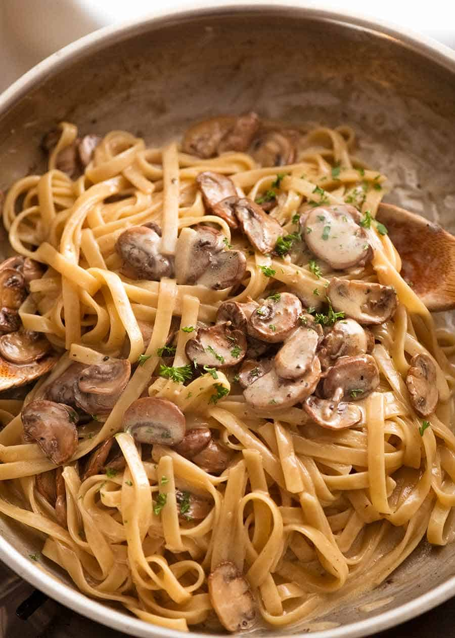 Mushroom pasta with Alfredo sauce in a pan, fresh off the stove