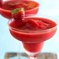 Close up of Frozen Strawberry Daiquiris by the pool - best summer cocktail!
