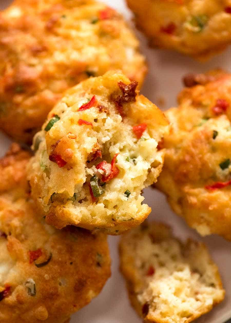Close up showing the inside of Mediterranea Savoury Muffins - cheesy muffins with olives, sun dried tomatoes, roasted peppers, feta and cheese