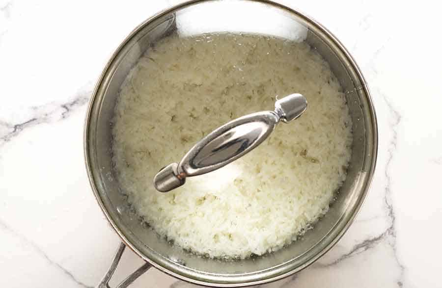 Resting rice in saucepan before fluffing it up