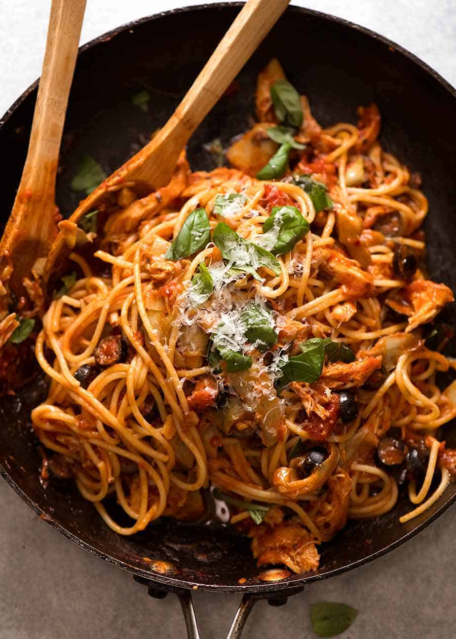 Sicilian Chicken Spaghetti in a black skillet, ready to be serced