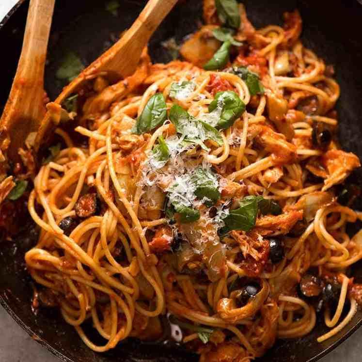 Sicilian Chicken Spaghetti in a black skillet, ready to be serced