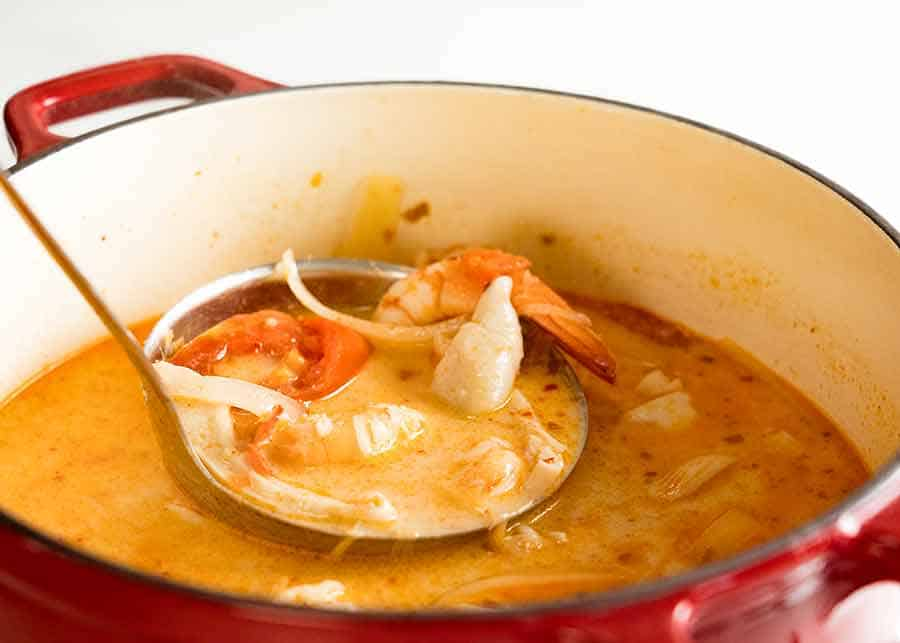 Pot with creamy Tom Yum Soup, fresh off the stove