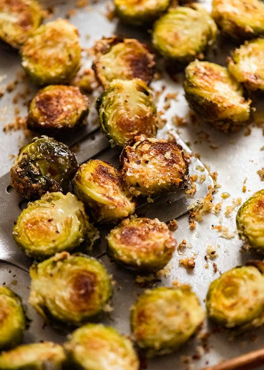 CRISPY Parmesan Garlic Roasted Brussels sprouts recipe on a tray, fresh out of the oven