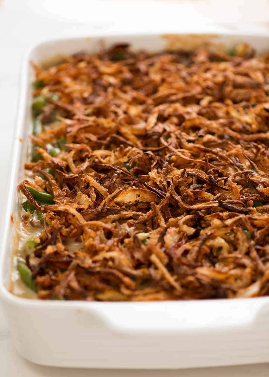 Green Bean Casserole covered with crispy fried onions, fresh out of the oven
