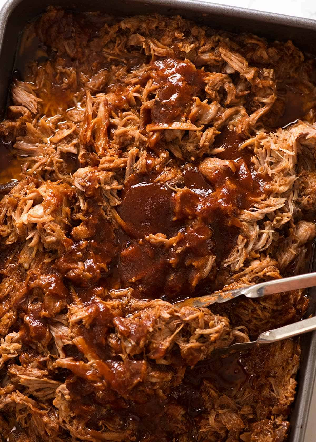 Large pan filled with Slow Cooker Pulled pork with BBQ Sauce