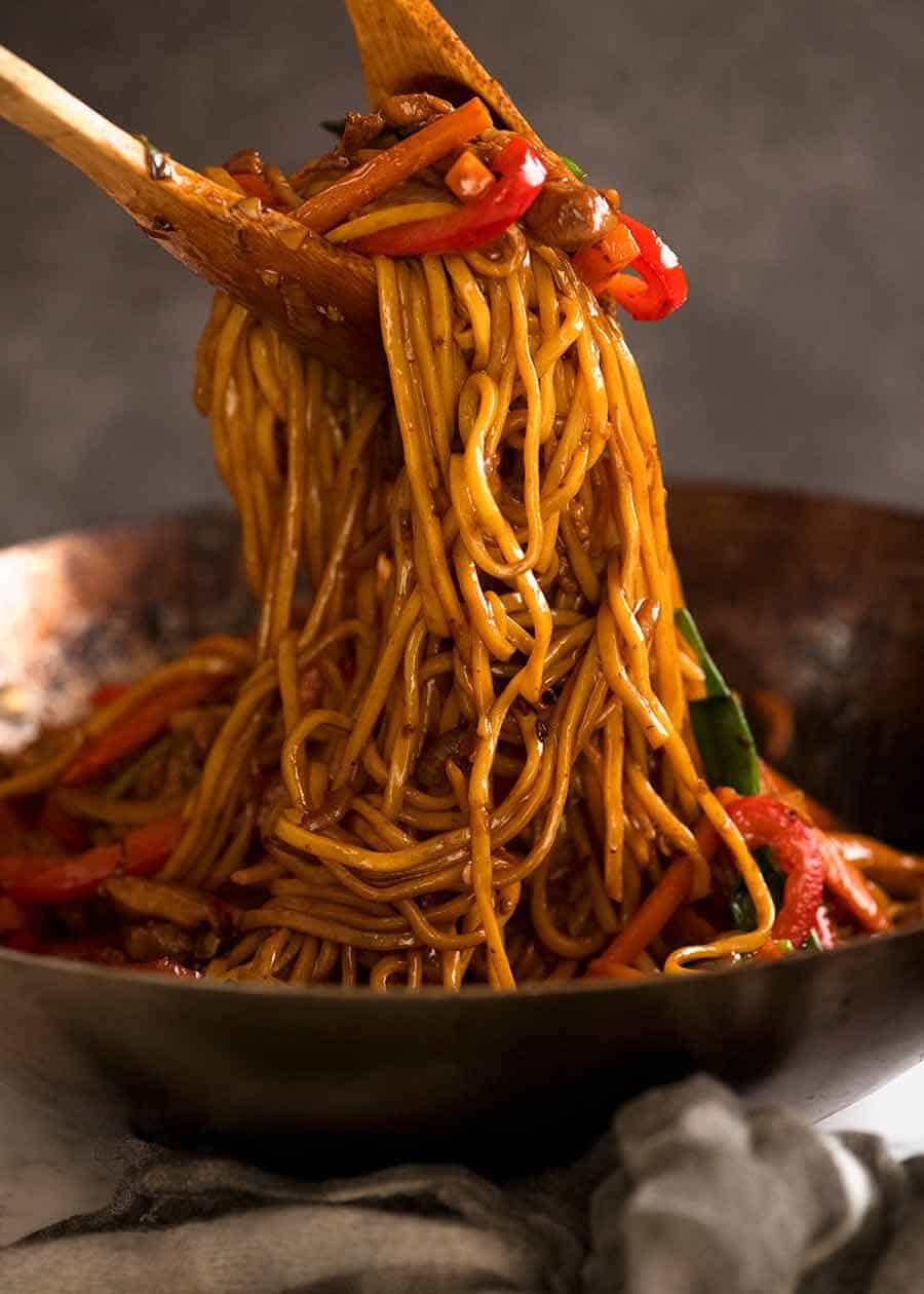 Tossing Lo Mein noodles in a wok