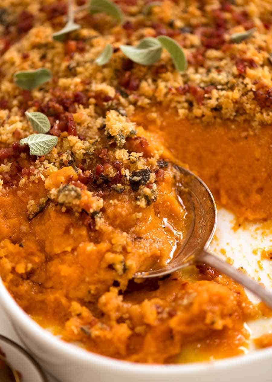 Close up of spoon serving Browned Butter Sweet Potato Casserole