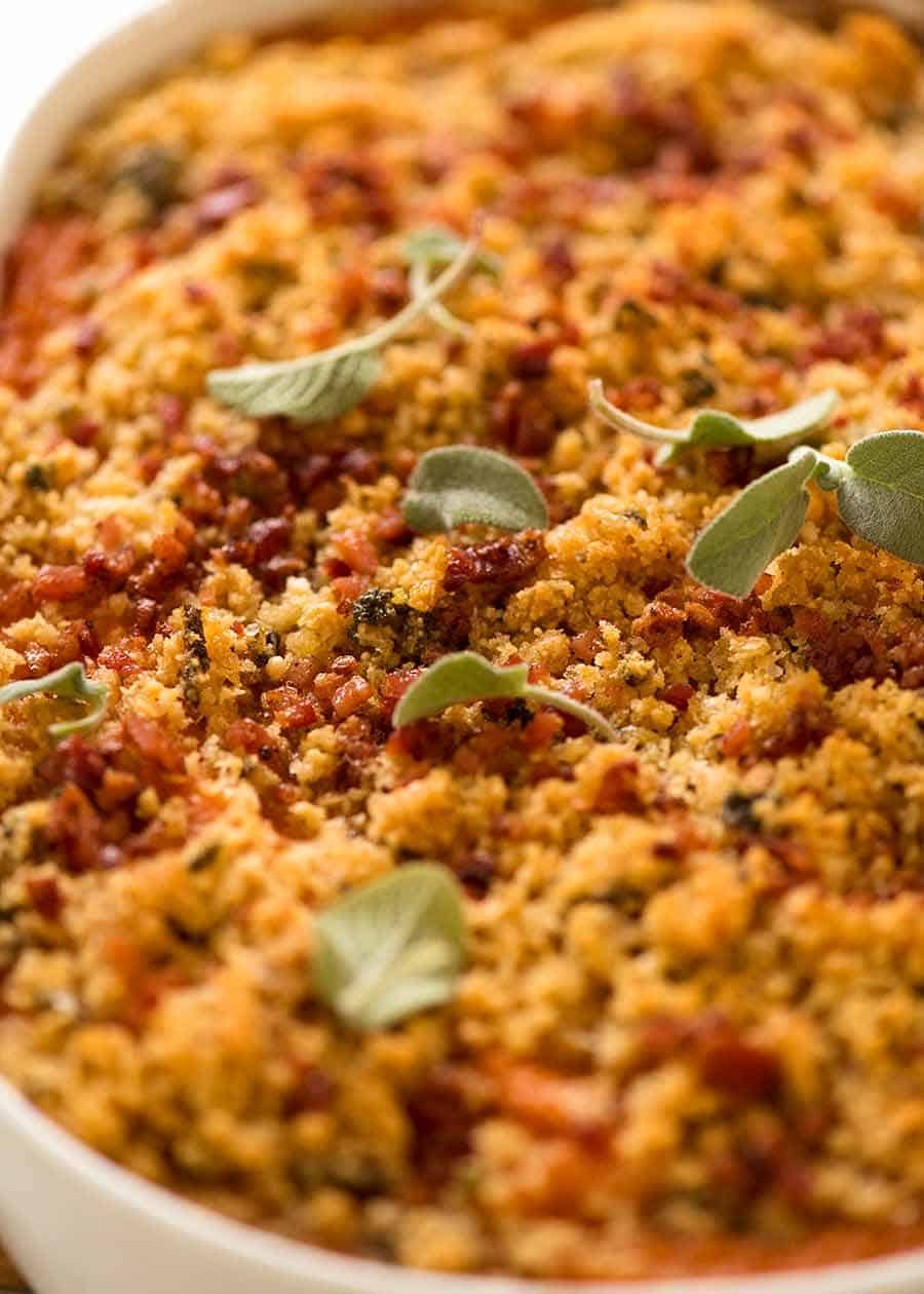 Close up of Browned Butter Sweet Potato Casserole crunchy parmesan topping