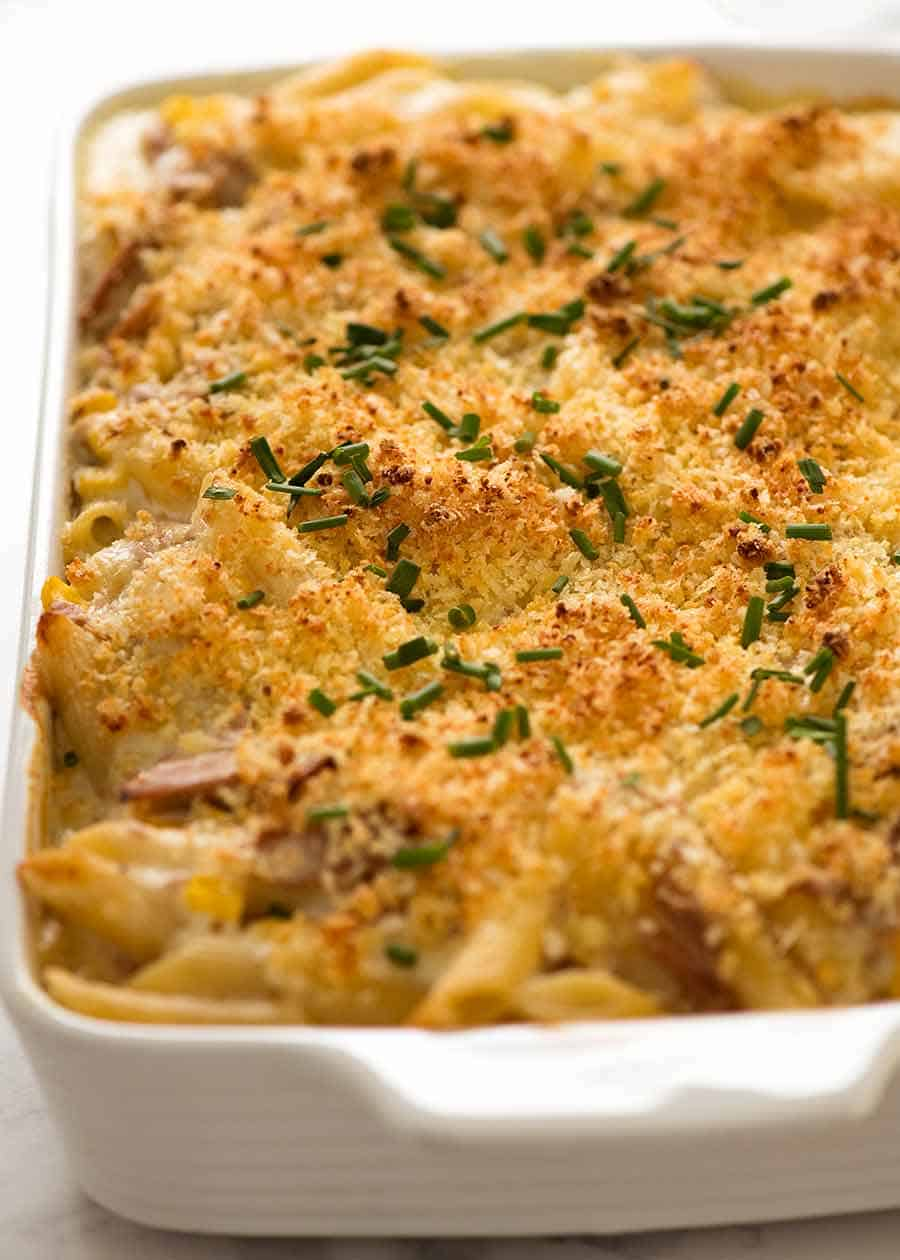 Creamy Tuna Pasta Bake in a white baking dish, fresh out of the oven