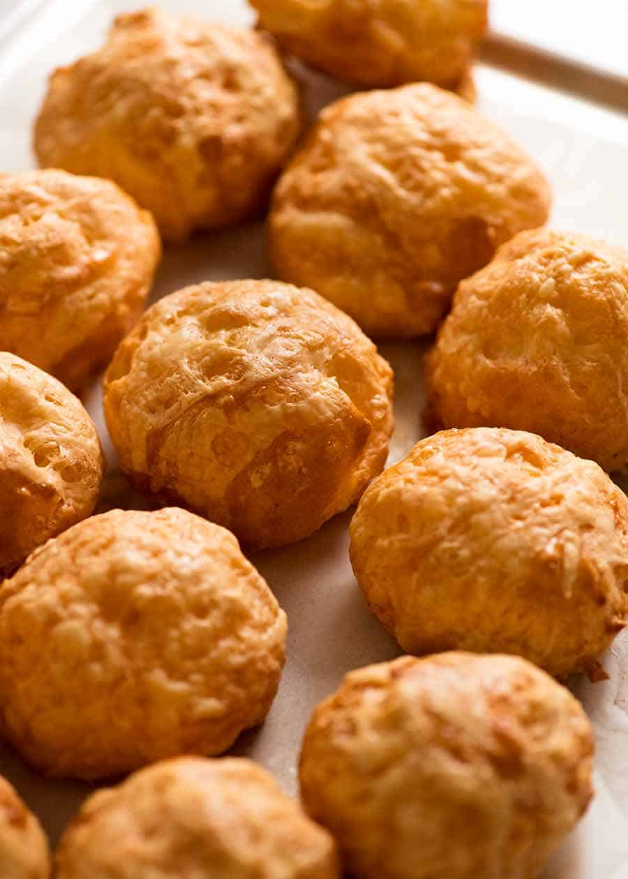 Tray filled with freshly baked Gougeres