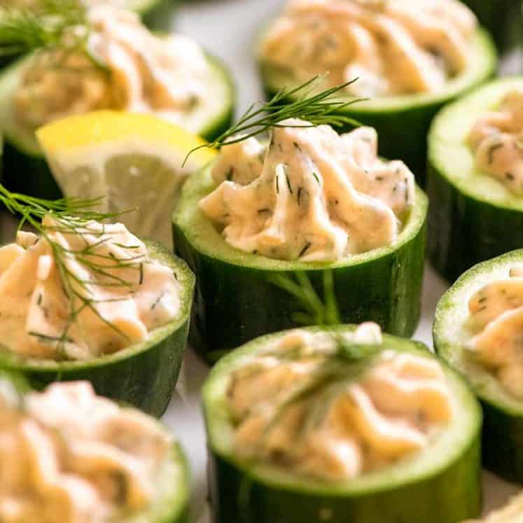 Close up of Cucumber Canapés topped with smoked salmon mousse garnished with dill