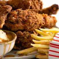 Photo of Fried Chicken with fries and potatoes and gravy