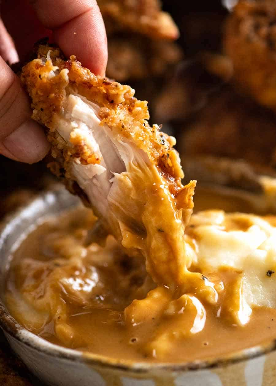 Dunking Fried Chicken into potato and gravy
