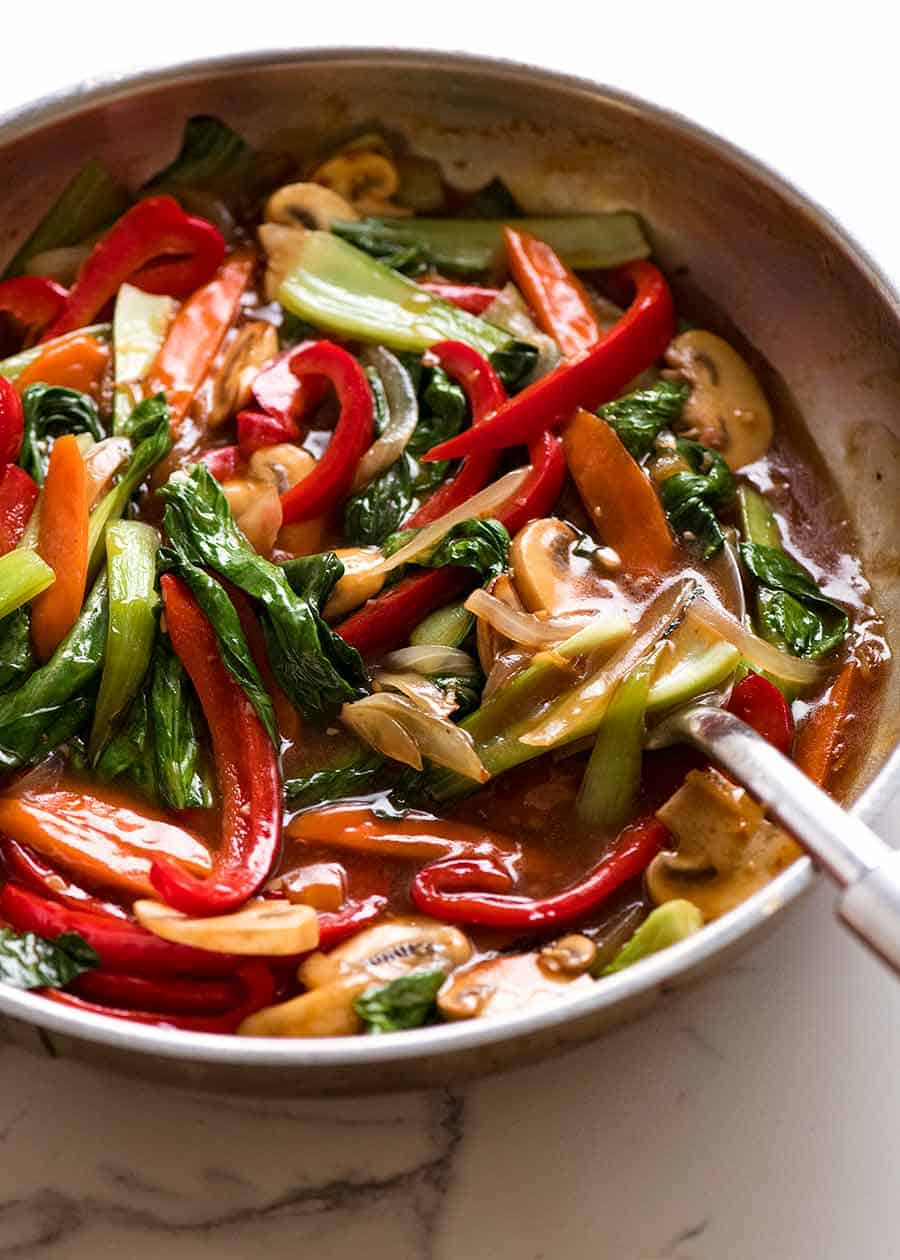 Skillet with sauce stir fried vegetables, fresh off the stove
