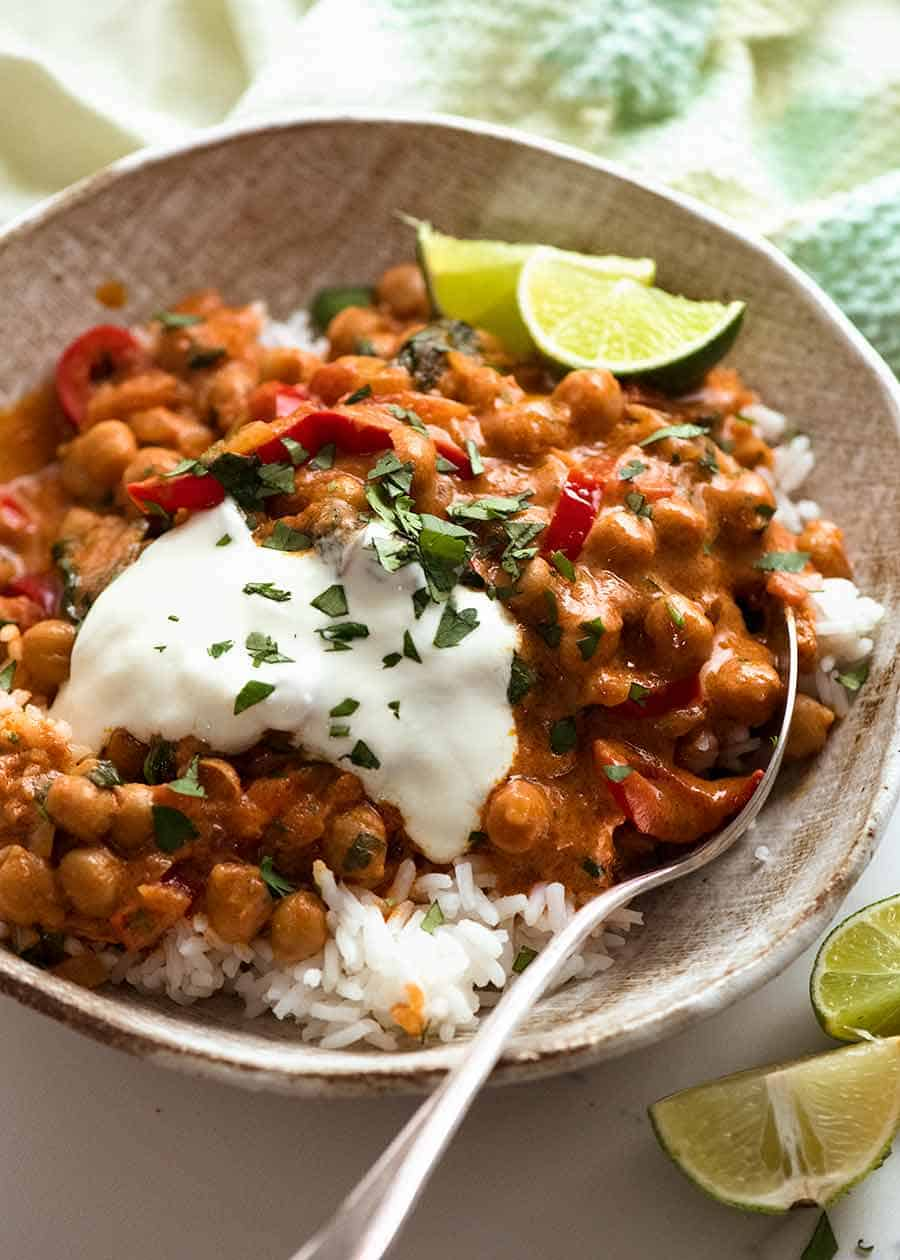 Brazilian Chickpea Curry in a bowl served over rice, ready to be eaten