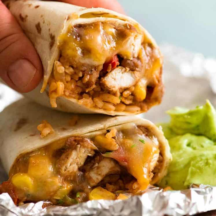 Hand picking up Chicken Burrito