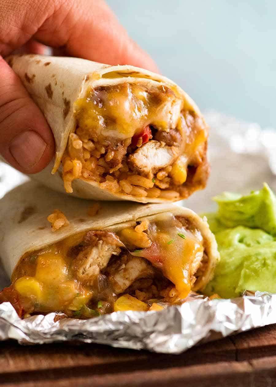 Hand picking up Chicken Burrito