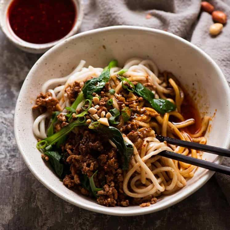 Bowl of spicy Sichuan Dan Dan Noodles, ready to be eaten