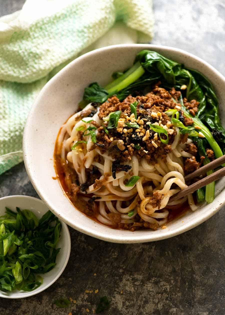 Dan Dan Noodles in a bowl, ready to be eaten