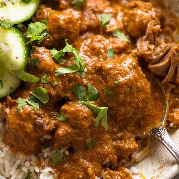Close up of Rogan Josh in a rustic bowl, served over basmati rice