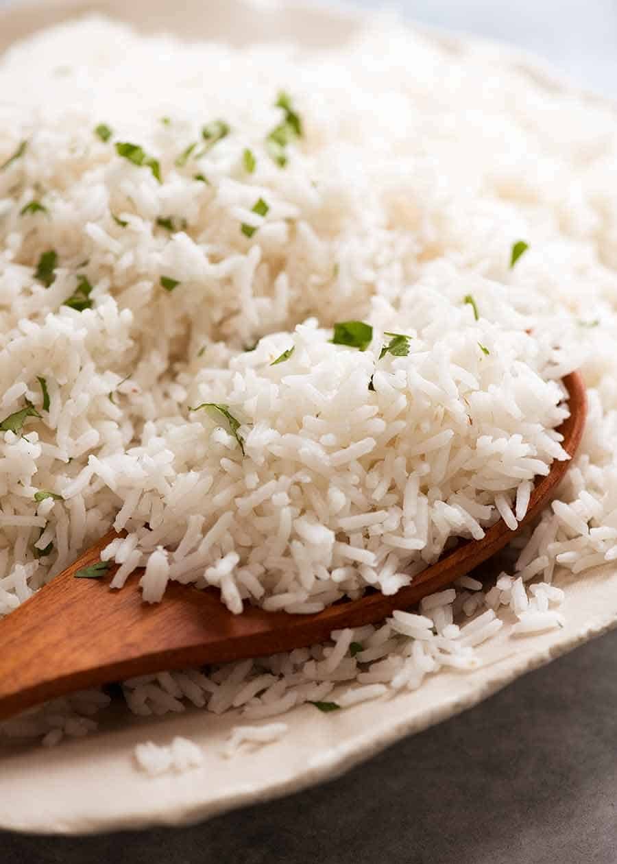 Close up of spoon scooping up fluffy Basmati Rice